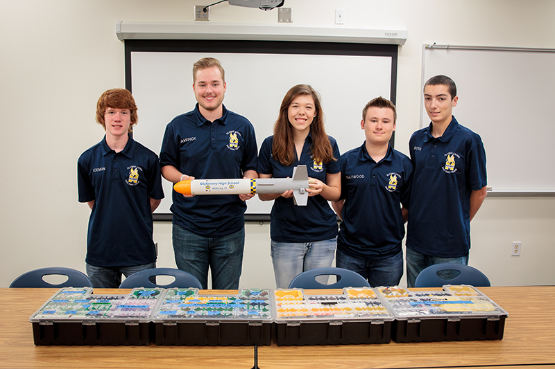 The MHS team holding their 2016 TARC rocket