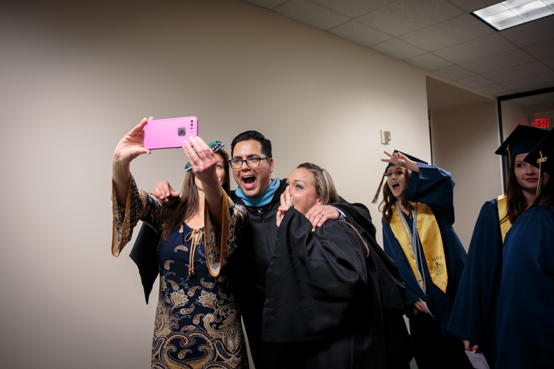 Teachers taking a selfie at graduation