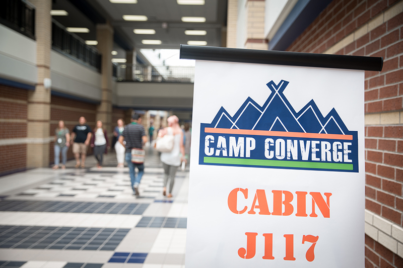 Close up of Camp Converge Breakout Session sign.