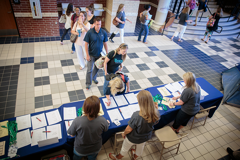 Overhead view of teachers signing in to conference
