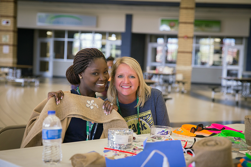 Two teachers in the maker space session smiling at the camera