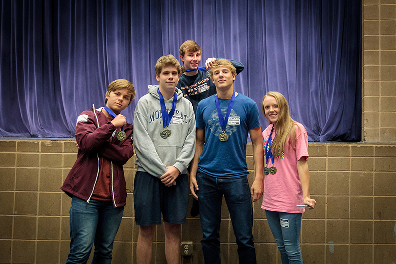 Group of students with medals