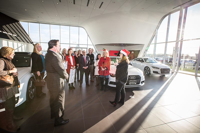 Sine talking to group at Sewell Audi showroom