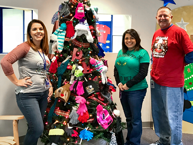 Principal, AP and CIS coordinator standing by tree