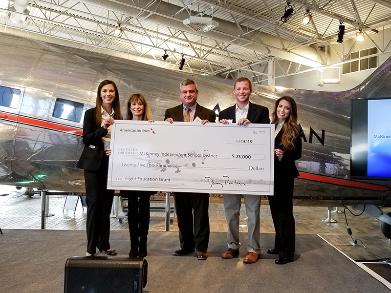 Reps from MISD and AA standing with oversized check