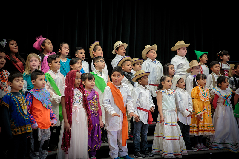 Choir of students in multicultural costumes.