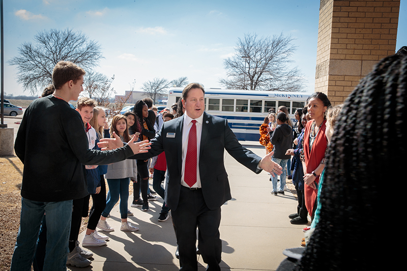 McDaniel shaking hands with students