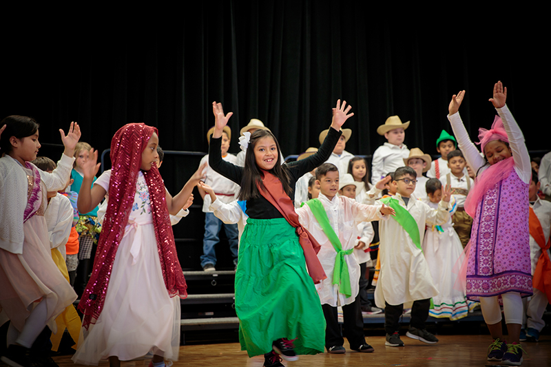 Students dancing in cultural costumes.