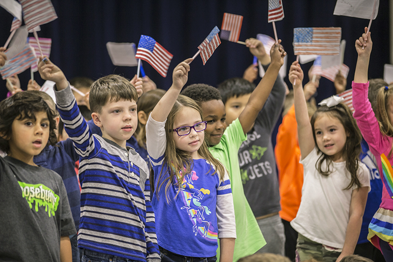 kids waving flags