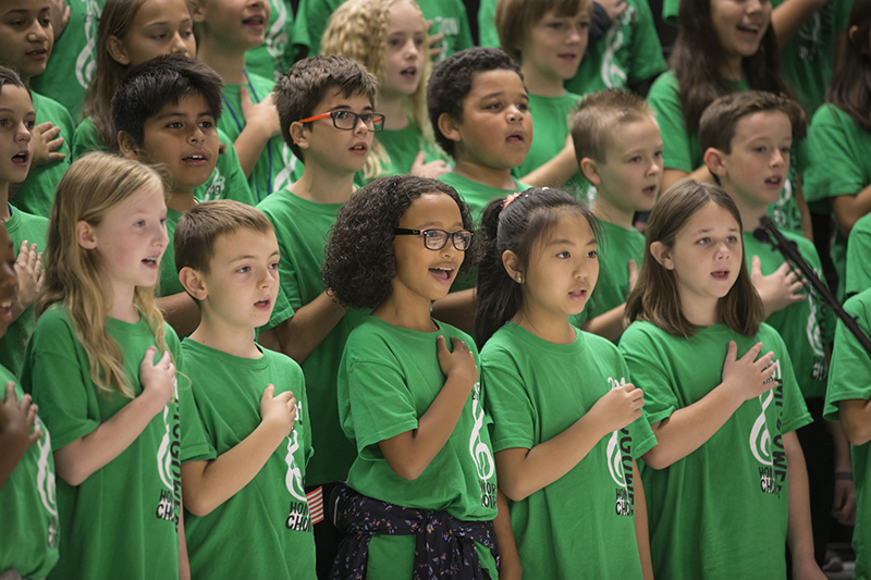 Kids in choir with hands on heart