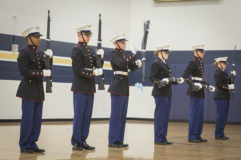 twirling rifles in a line