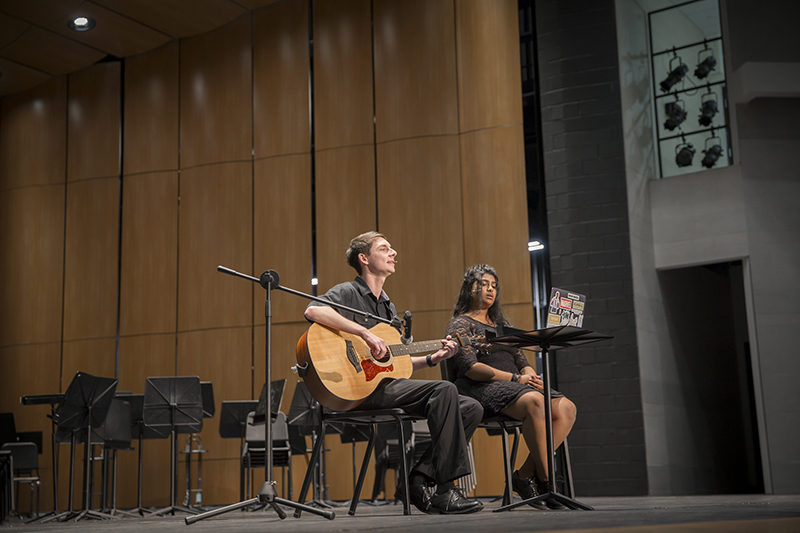 duo with guitar singing onstage