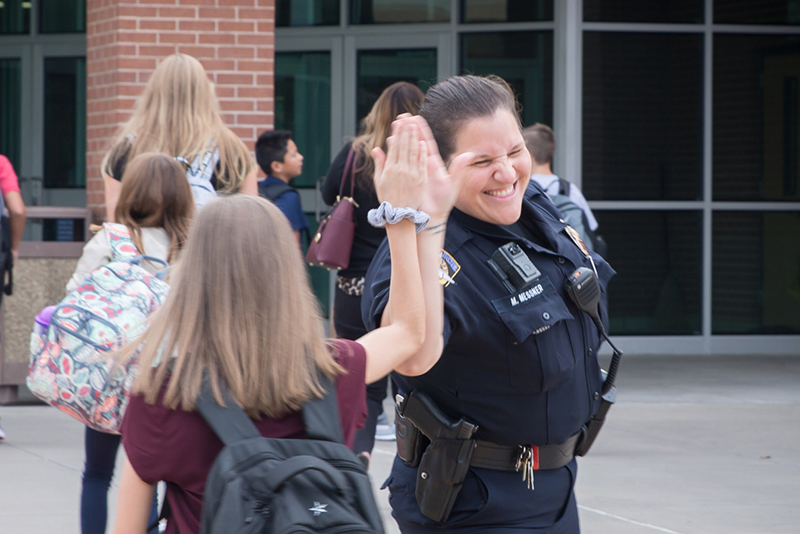 high fiving a student during arrival