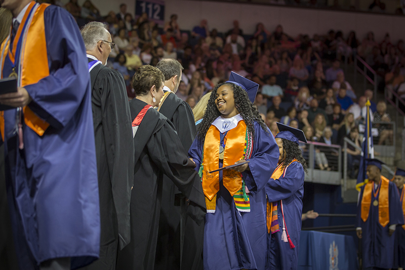 female graduate shaking hands with board member