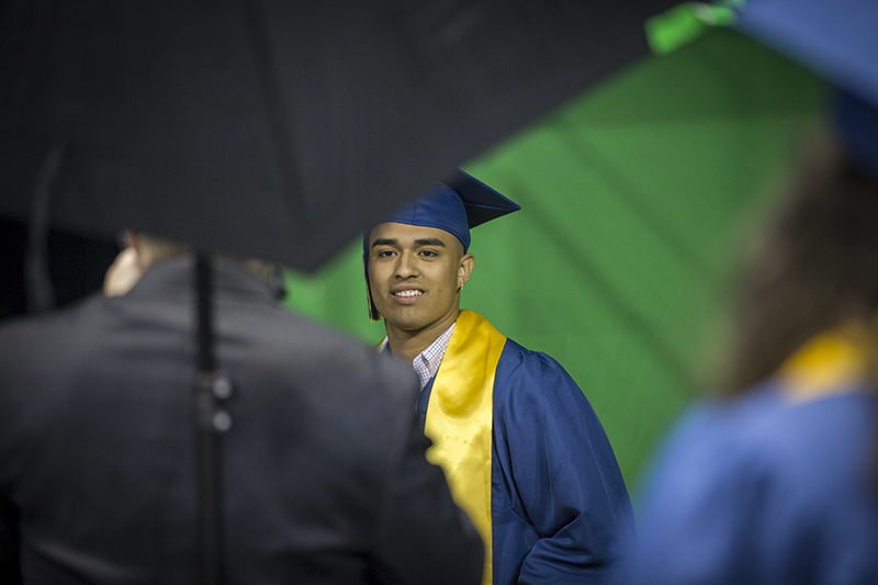 male student smiling for camera