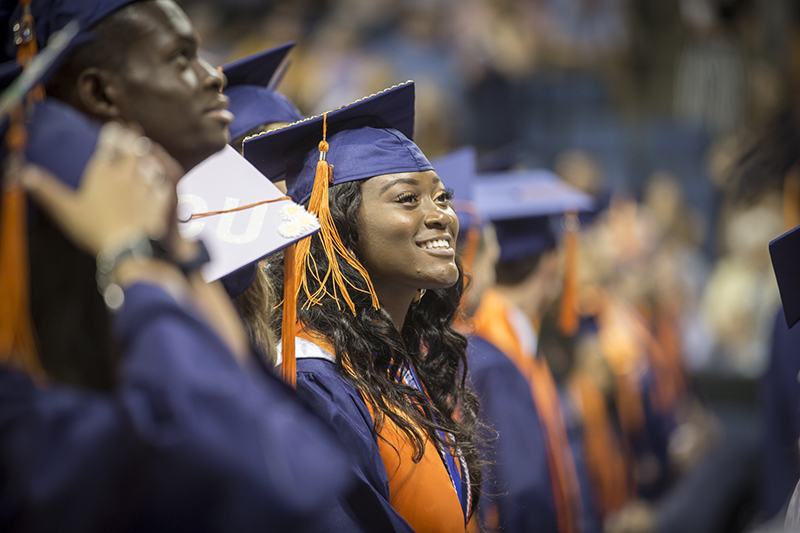 female graduate standing in row smiling