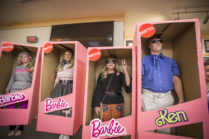 in Barbie and Ken costumes