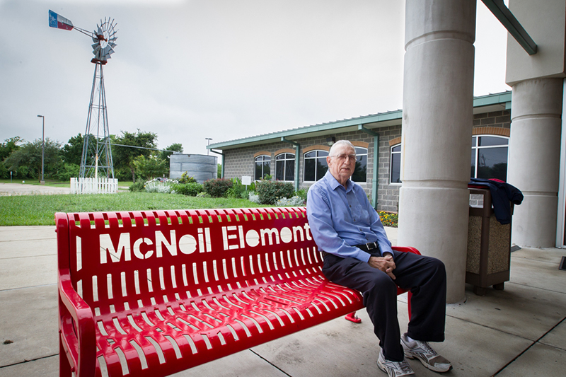McNeil sitting on bench