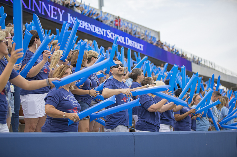 staff in stands waving thunder sticks