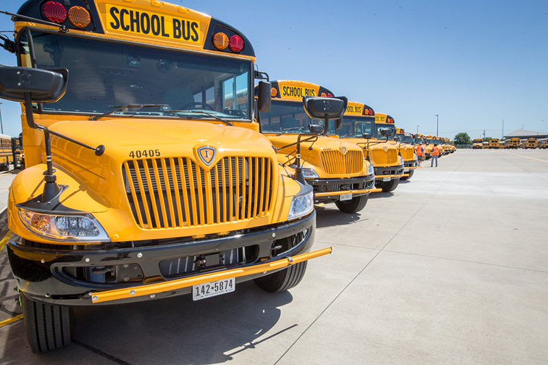 Yellow school buses in a long row