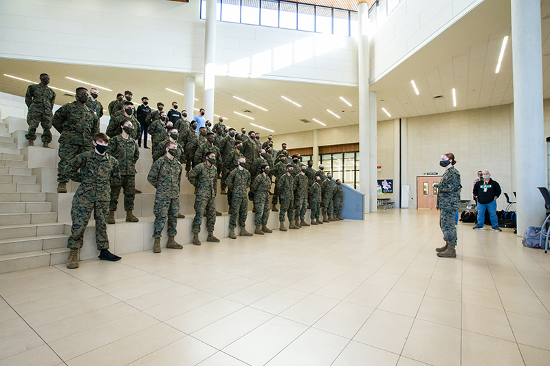 Kylie standing in front of battalion as she addresses them