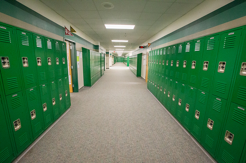 view down hall with bright green lockers