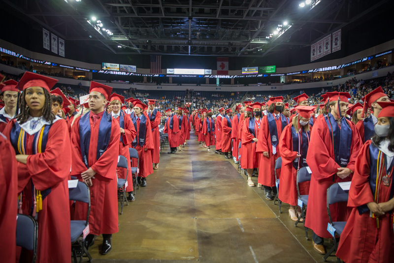 view of graduates on both sides of center aisle