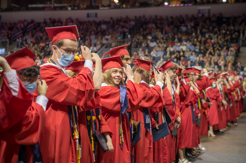 line of students turning tassels
