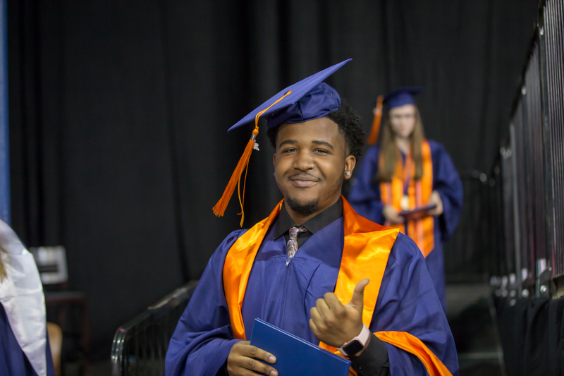 male student gives thumbs up