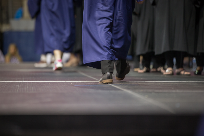 view of feet walking across stage