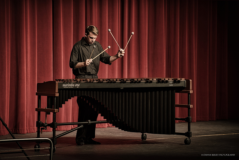 male percussionist playing xylophone onstage