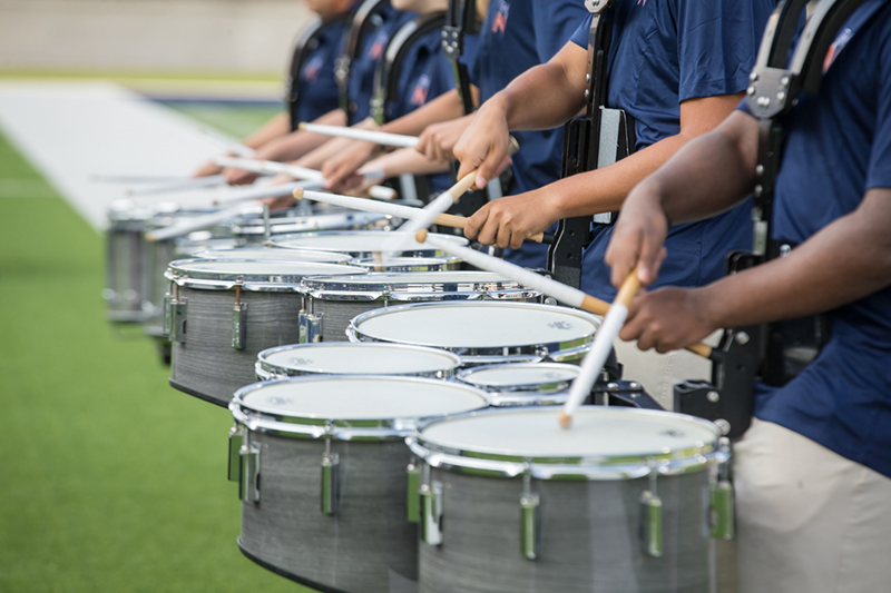shot of drummers in a line playing