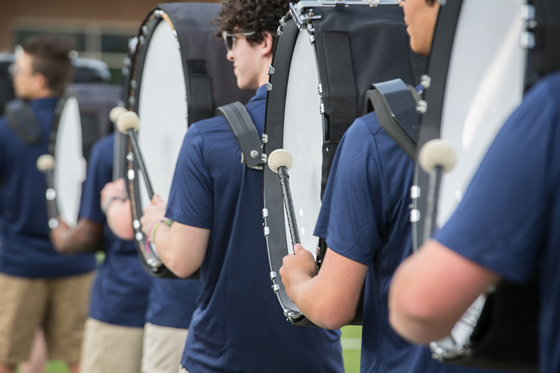 view of bass drummers in a row