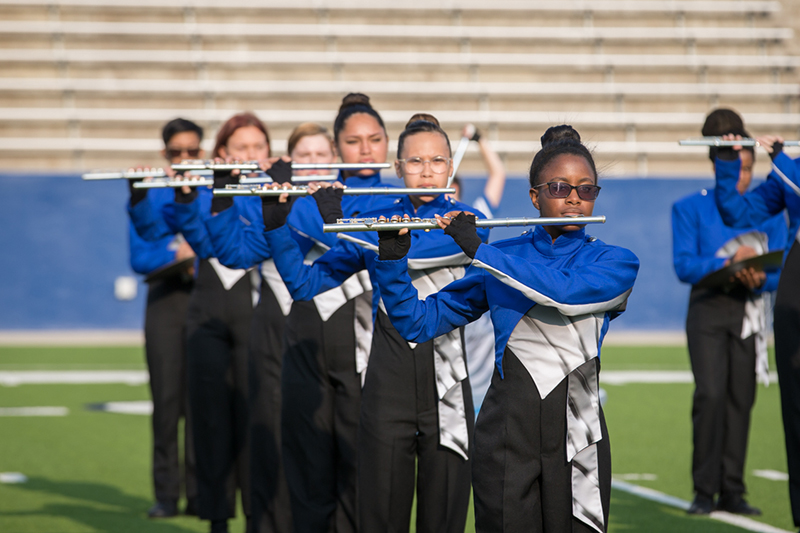 line of flute players performing on field