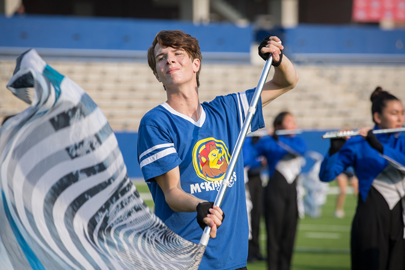 color guard member performing on field with flag