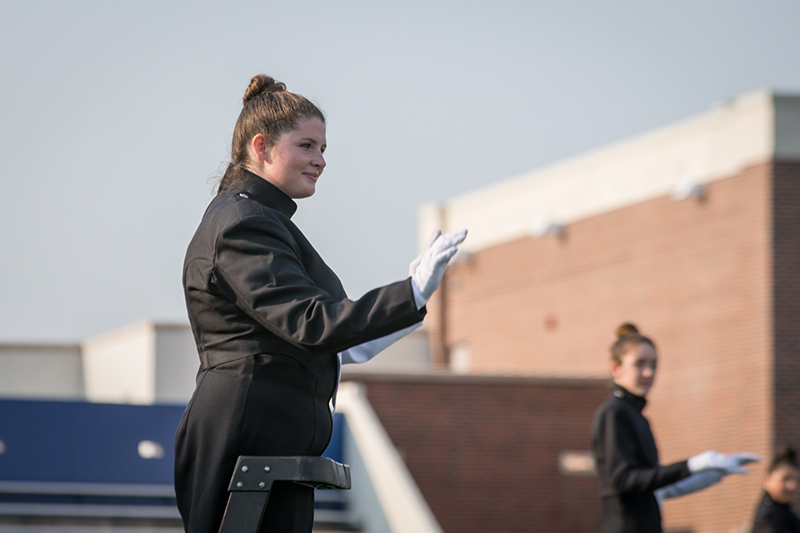 drum major on pedestal directing band as they perform