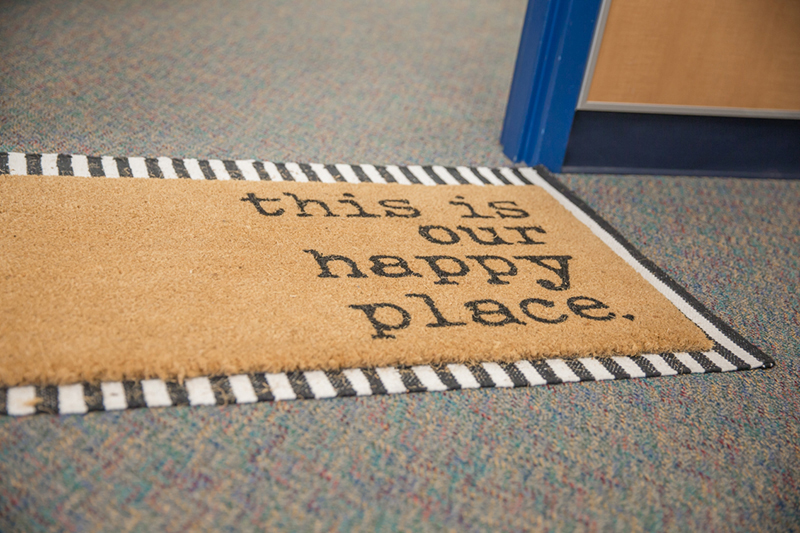 doormat in front of classroom door that reads this is our happy place