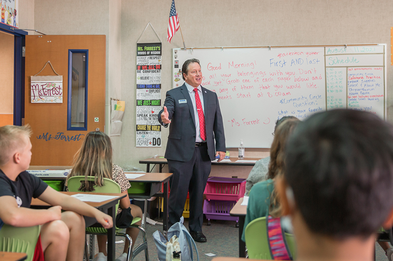 Rick McDaniel greeting students from front of class