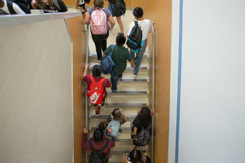 overhead view of stairway as students walk up